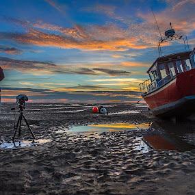 Photographer at work by Paweł Saj - Transportation Boats ( work, sunset, boats, photographer, boat, man, , blue, orange. color )