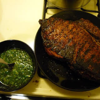 Perfectly Grilled Flank Steak With Chimichurri Sauce.