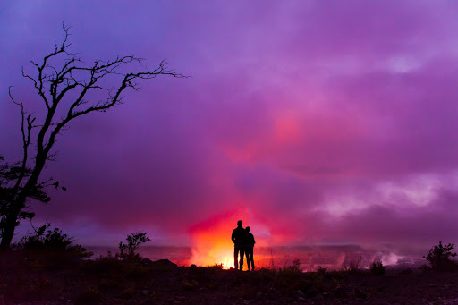 Halemaumau-Crater-volcano - A couple overlooks Halemaumau Crater on the the Big Island of Hawaii.