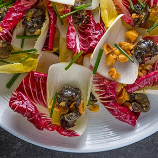 Endive and Radicchio Salad with Snails and Toasted Hazelnuts.