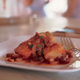 Salt Cod with Raisins and Pine Nuts in Tomato Sauce (Baccalà in Guazzetto).