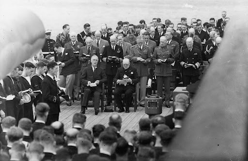 Franklin D. Roosevelt and Winston Churchill singing during services aboard the HMS Prince of Wales at the Atlantic Charter Conference