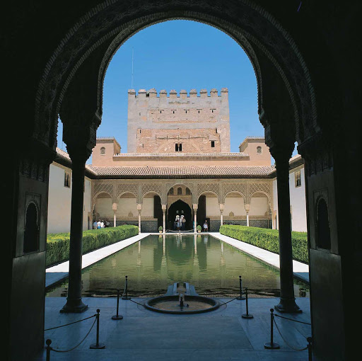 These clear waters at the Court of the Myrtles (Patio de los Arrayanes) are located in the palace complex of historic Alhambra in Granada, Spain.