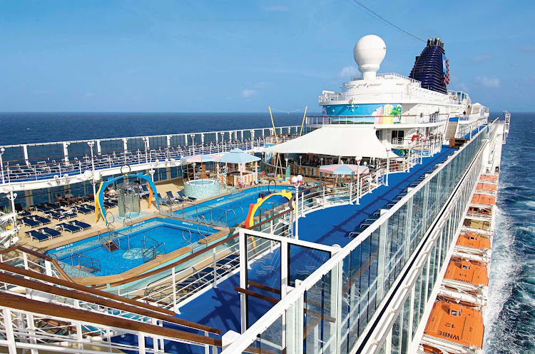 Inspired by Miami's South Beach, the South Beach Pool on deck 12 of Pride of America boasts hot tubs, deck chairs and two magnificent outdoor pools.