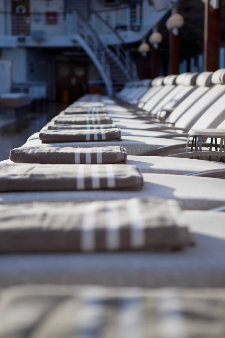 The sun, a breeze and a comfortable chair provide everything you need for an afternoon of relaxing poolside on an Azamara cruise.