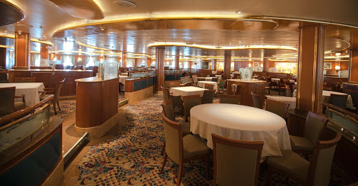 Star-Princess-Capri-dining-room - The Capri dining room, one of three main dining rooms aboard Star Princess. It's midship on deck 5 and open for anytime dining at dinnertime.