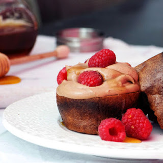 Cocoa Popovers with Chocolate Mousse and Raspberries.