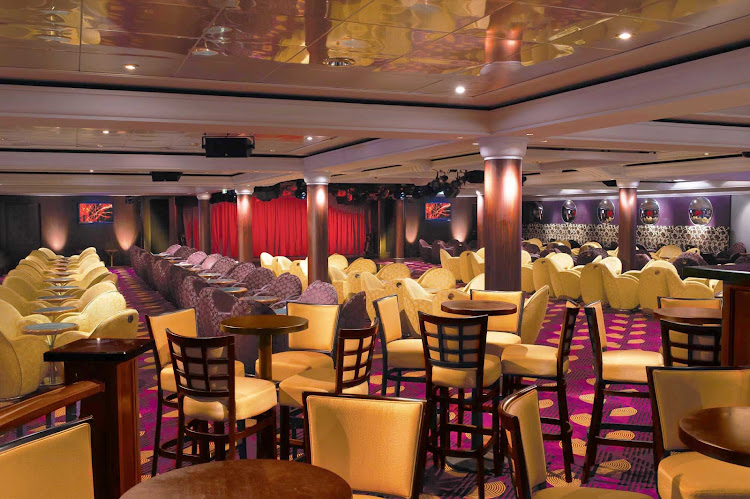 Put on those dancing shoes after drinking a cocktail or two in Norwegian Star's festive Spinnaker Lounge.