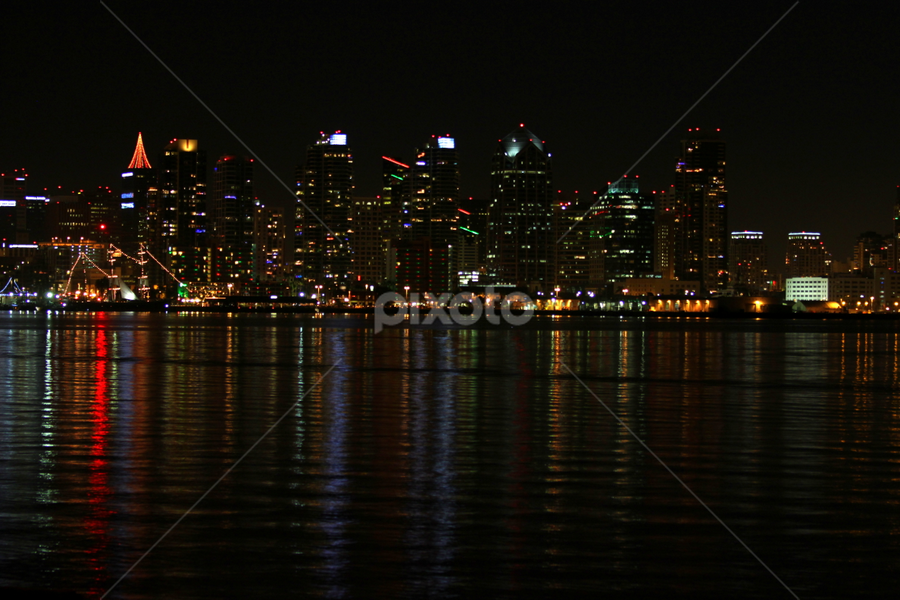 San Diego Skyline Night by Henrik Lehnerer - City,  Street & Park  Night ( skyline, reflection, harbor, america, colorful, street, reflections, ocean, cityscape, architecture, landscape, usa, dock, city, mirror, modern, lights, sky, skyscraper, nature, buildings, evening, built, light, commercial, downtown, water, diego, building, structure, california, colors, beautiful, romantic, sea, pacific, san diego, tourism, dusk, urban, tourist, san, bay, outdoor, scene, night, waterfront )
