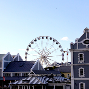 Big Wheel by Leanne Oosthuizen - Buildings & Architecture Public & Historical ( clear, wheel, blue, bright, buildings, day, skies )
