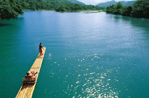 guided-raft-tour-Jamaica - A guide takes guests on a scenic tour of one of Jamaica's inland waterways.