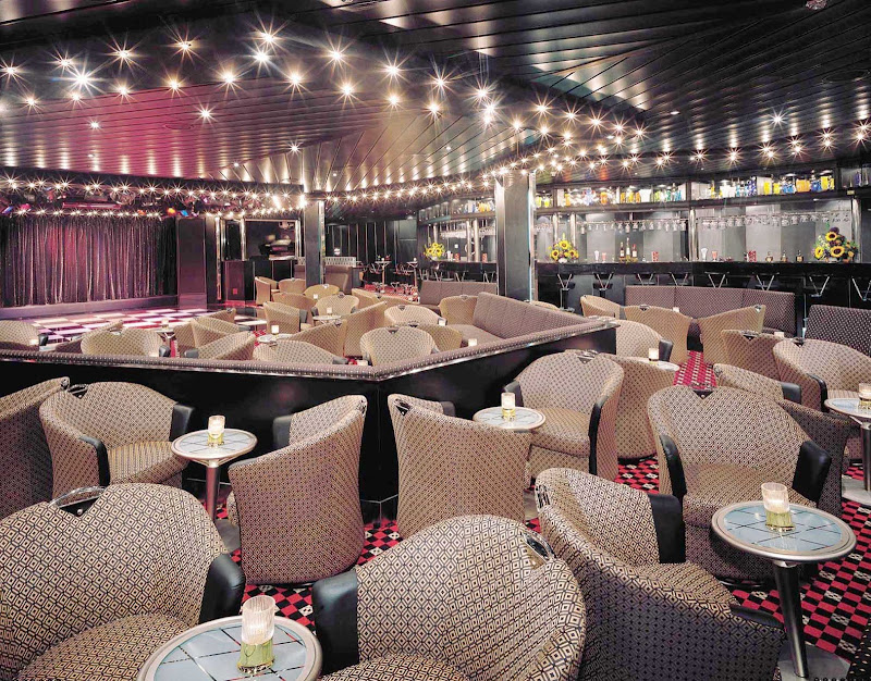 Be entertained with cabaret performances while drinking and dining at Norwegian Sky's Dazzles Nightclub.