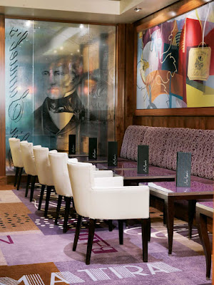 Try a glass of fine wine or a cappuccino and fresh baked pastries at Sir Samuel's wine bar aboard Queen Mary 2.