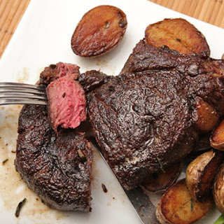 Butter-Basted Bison Ribeye Steak with Crispy Potatoes.