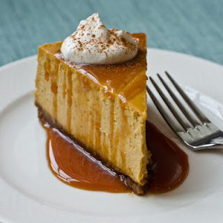 Pumpkin Cheesecake with Gingersnap Crust and Caramel Sauce