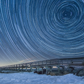 341° N by Matthew Robertson - Landscapes Starscapes ( stars, snow, bass hole, long exposure, night, star trails, beach, north star, boardwalk, cape cod )