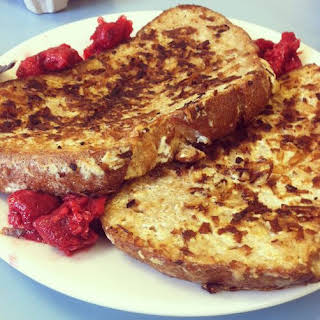 Coconut Encrusted French Toast with Raspberries.