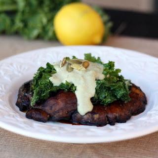 Meaty Portobellos and Lemon Kale Topped with Pumpkin Seed Cream.