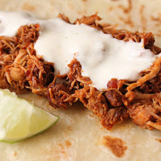 Saucy Slow-Cooked Shredded Chicken Tacos.