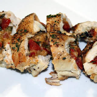Chicken Breasts Stuffed with Asiago Cheese, Tomatoes and Roasted Red Peppers.
