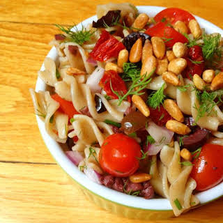 Pasta Salad with Tomatoes, Kalamata Olives and Toasted Pine Nuts.
