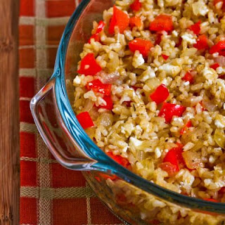 Greek-Inspired Leftover Brown Rice Casserole with Red Pepper, Onions, and Feta.