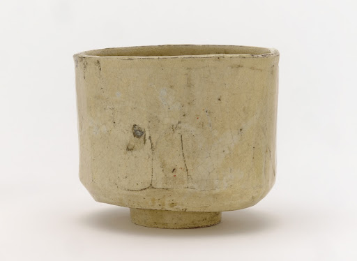 White Raku tea bowl with facets