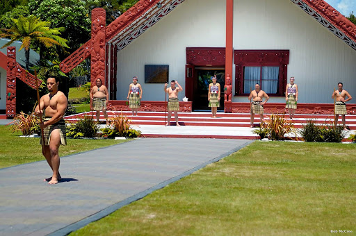 Traditional_Maori_welcome_Rotorua - Preserving traditional Maori culture and customs often involves sharing authentic experiences with visitors to New Zealand. At Te Puia in Rotorua, guests are welcomed onto the marae (tribal meeting place) in the traditional manner and in front of the wharenui (sacred meeting house). After taking part in the powhiri (welcoming ceremony), you are forever linked to the marae.