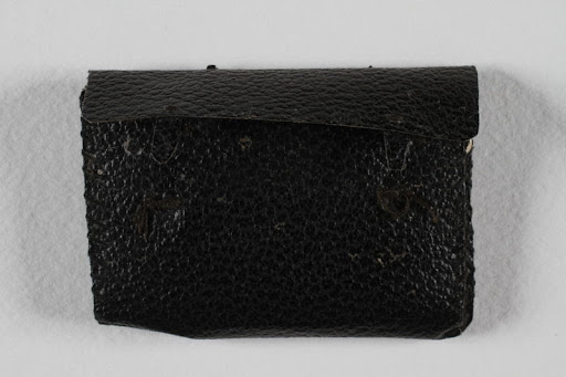 Small leather wallet with buckle used by a teenage girl to hold her diary in a labor camp