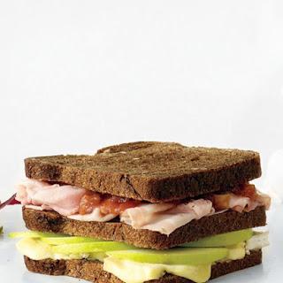 Ham, Brie, and Apple Triple-Decker Sandwich.