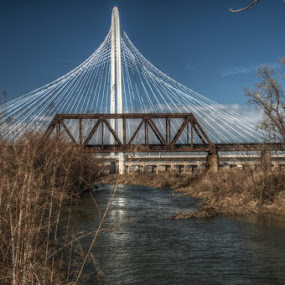 by Michael McMurray - Buildings & Architecture Bridges & Suspended Structures ( truss bridge, stream, trinity river, suspension bridge, flowing, dallas, texas, iron bridge, bridges, margaret hunt hill bridge, river )