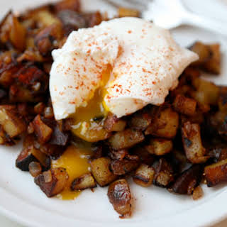 Paprika-Spiked Home Fries with Poached Egg.