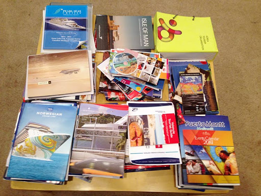Some of the marketing collateral that I shipped to my home last year from Cruise Shipping Miami. Ship cool stuff, not analog!