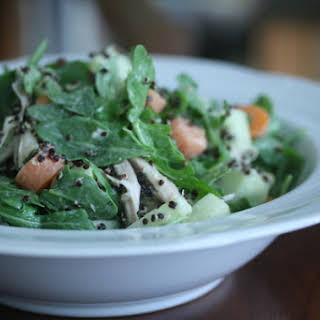 Arugula Salad with Chicken, Black Quinoa, and Lemon-Tahini Dressing.