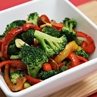 Sautéed Broccoli With Yellow And Red Bell Peppers.