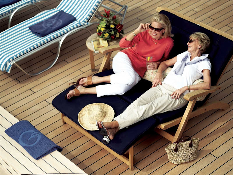 Chat up a friend and enjoy refreshments at poolside during your sailing on Oceania Regatta.