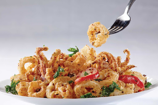 Norwegian-Cruise-Line-food-Ocean-Blue-calamari - Enjoy crispy calamari at Ocean Blue, one of the restaurants overssen by renowned chef Geoffrey Zakarian on Norwegian Breakaway and Norwegian Getaway.