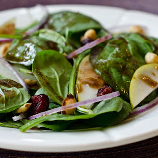 Baby Spinach Salad with Pears, Red Onions, Cranberries and Toasted Hazelnuts