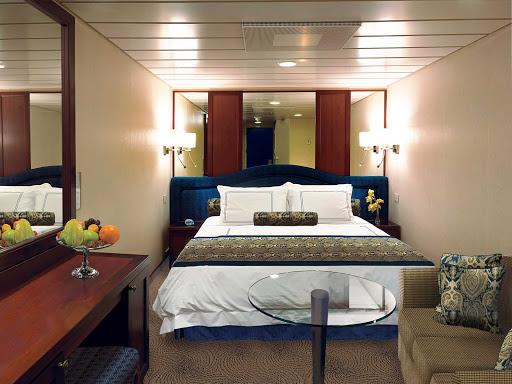 Oceania-F-G-Inside-Stateroom - Inside staterooms on Oceania Regatta contain a queen bed with 1,000-thread-count linens, seating area, vanity desk, refrigerated mini-bar, breakfast table, Bulgari amenities, flat-screen TV with live satellite and twice-daily maid service.