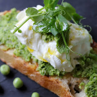 Seasonal Crostini with Crushed Peas, Mint, and Mozzarella Cheese.