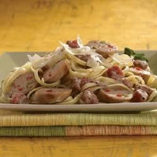 Grilled Sweet Italian Chicken Sausage with Tomato Cream Sauce Over Linguine.