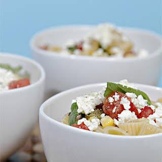 Pasta Salad with Heirloom Tomatoes, Pan-Roasted Zucchini, Fresh Corn and Goat-Milk Feta.