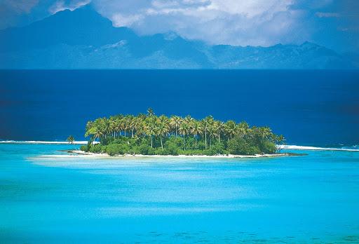 """Raiatea_Isle - A view of the Raiatea Isle, known as """"the sacred isle,"""" in French Polynesia aboard the Paul Gauguin."""