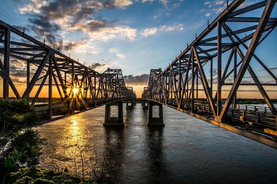 Sunset Between the Spans by Michael Chapman - Buildings & Architecture Bridges & Suspended Structures ( sunset, natchez, mississippi river bridges, natchez bridges, bridges,  )