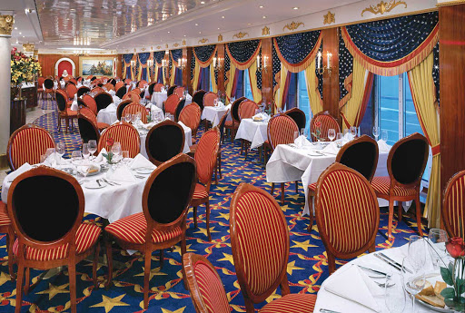 Norwegian-Pride-Of-America-Dining-Liberty - The Liberty Main Dining Room aboard Norwegian Cruise Line's  Pride of America features American Colonial-inspired furniture and accents.
