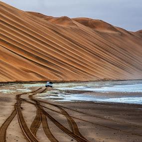 Langewand by Johan Jooste Snr - Landscapes Deserts ( dunes, namib desert, 4x4 vehicle, sea, tracks, namibia )