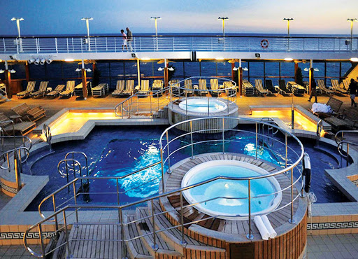 Oceania-RClass-pool-3-1 - Oceania Insignia's large heated pool and whirlpool spas are the ideal location to unwind and enjoy your travels.