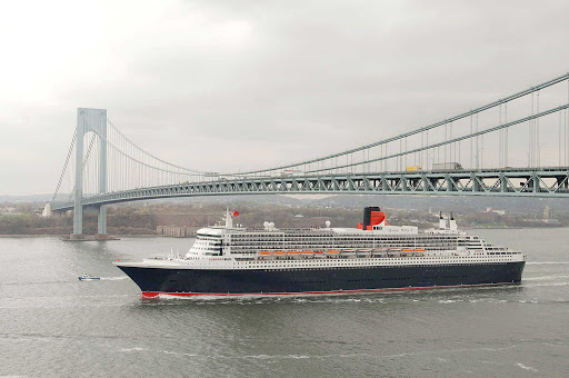Cunard-Queen-Mary-2-in-New-York - Queen Mary 2 sails beneath the Verrazano Bridge on the Hudson River in New York before making a transatlantic crossing.
