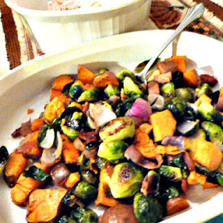 Roasted Brussels Sprouts and Sweet Potatoes with Turkey Bacon, Red Onion, and Balsamic Drizzle.