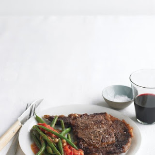 Rib Eye Steaks with Sauteed Green Beans and Tomatoes.